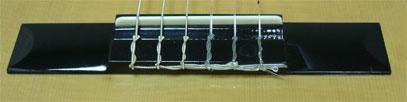 Подставка для струн классической гитары